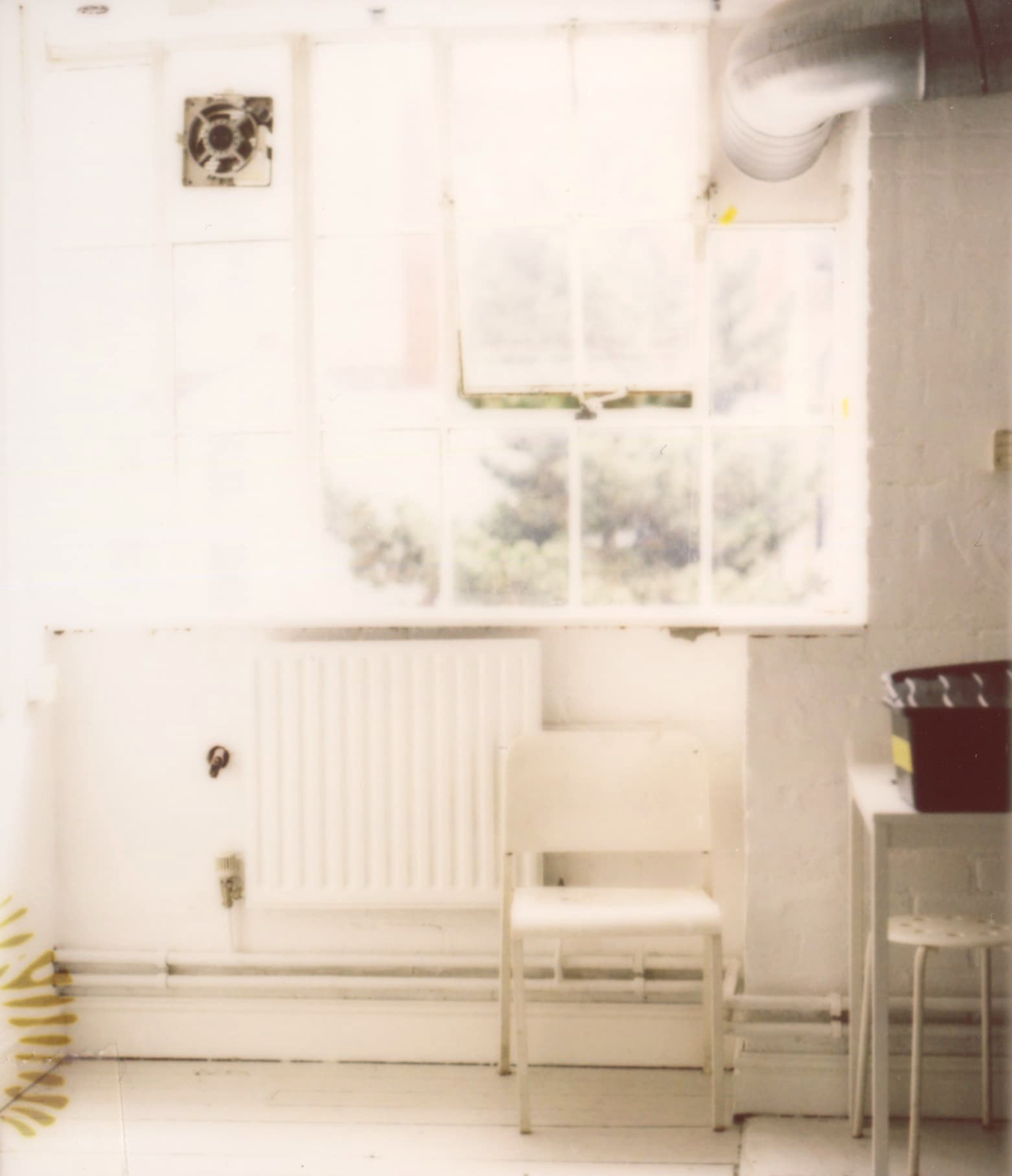 Studio window and furniture, all white. Scanned instant film. By Michael Chalmers, 2021