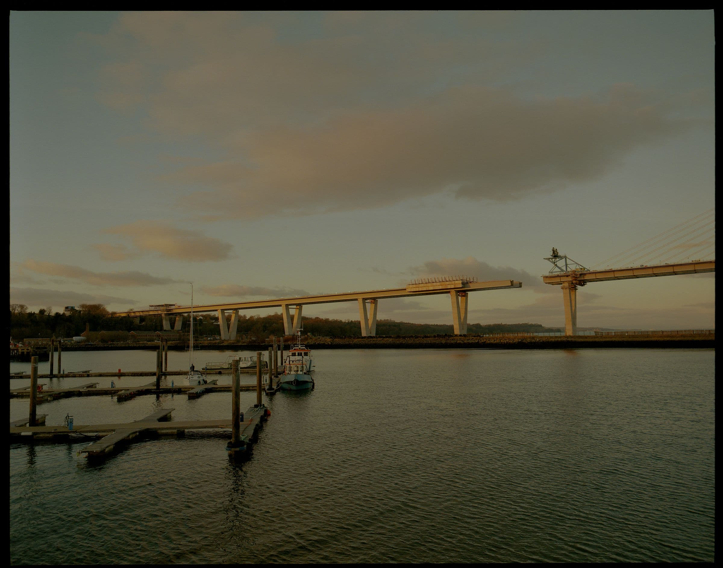 The Queensferry Crossing bridge being built, from Port Edgar during sunrise